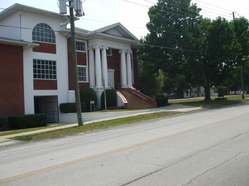 Haines City Church For Sale - Historic Sanctuary, Fellowship Hall, Classrooms, Nursery, Preschool, and Parking Lot - $950,000